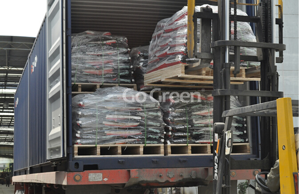 Bagged cold mix asphalt container loading
